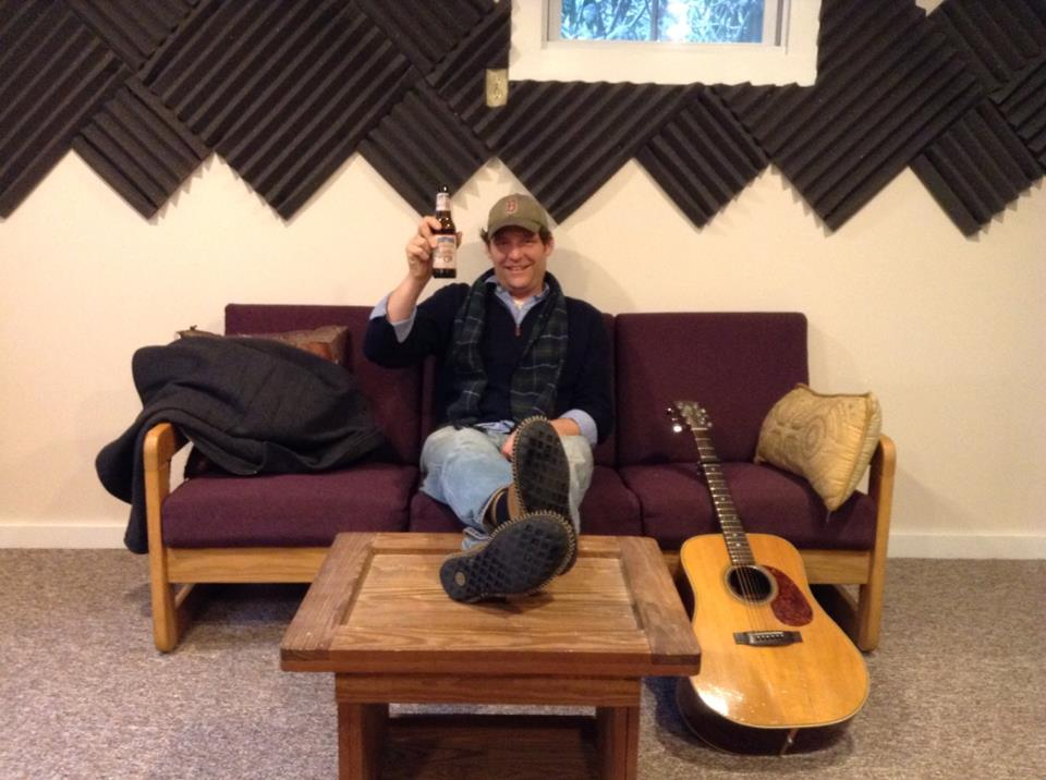 Paddy Mills on the listening couch with evening beverage
