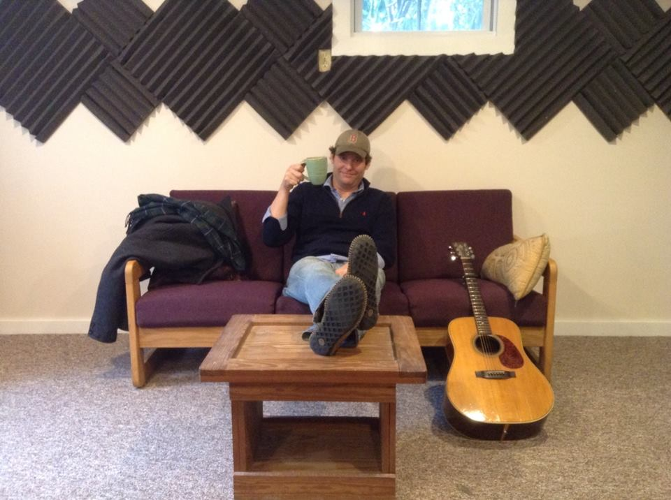 Paddy Mills on the listening couch with morning beverage